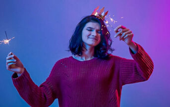 young woman with sparklers enjoying New Year's Eve alone