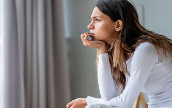 a young woman ruminating - learn how to stop
