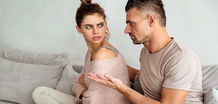 man belittling partner by telling her to calm down and being condescending