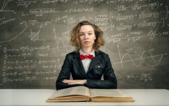 highly intelligent woman in front of chalkboard