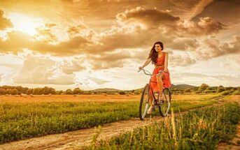 woman riding bike and being independent of her relationship