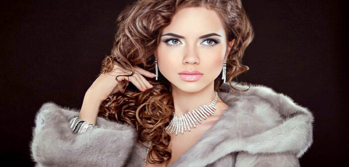 woman in fur coat with expensive jewelry - illustrating a snob