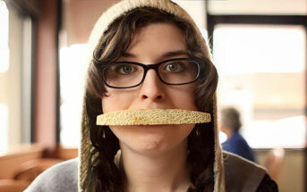 weird woman with fruit peel over her mouth
