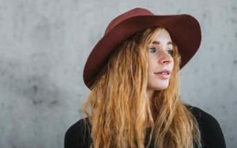 young woman with a red hat looking cool