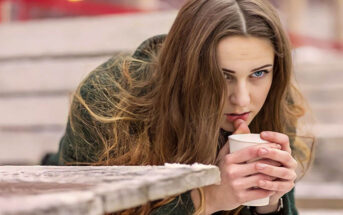 pensive woman holding a coffee to illustrate feeling like her life is going nowhere