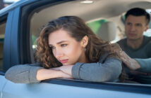 woman looking out of car window with boyfriend in the other seat - illustrating an on-again-off-again relationship