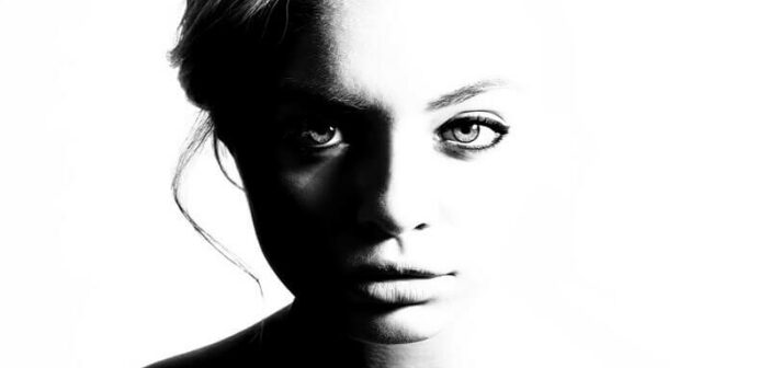 black and white photo of a young woman looking straight at the camera - how to be true to yourself