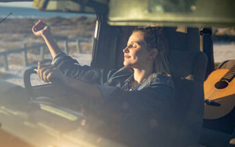 woman sitting in car enjoying sun - making every day count