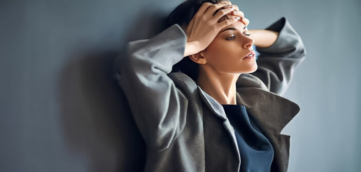 woman looking sad with hands on her forehead because she misses her boyfriend so much