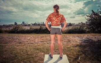 woman standing tall looking out over city - illustrating taking control of your life