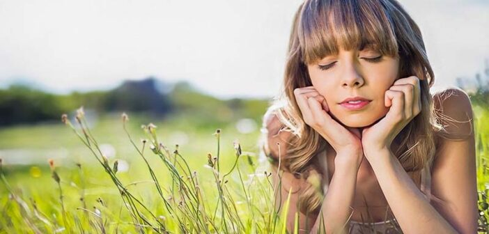 pensive woman on grass living in fear all the time