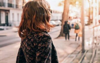 young woman walking on the street living without regret