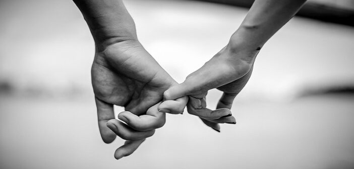black and white photo of couple holding hands
