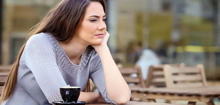 despondent woman sitting with coffee because she is making too many sacrifices in her relationship