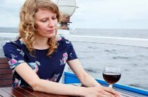 woman sitting alone on a boat feeling alienated by society