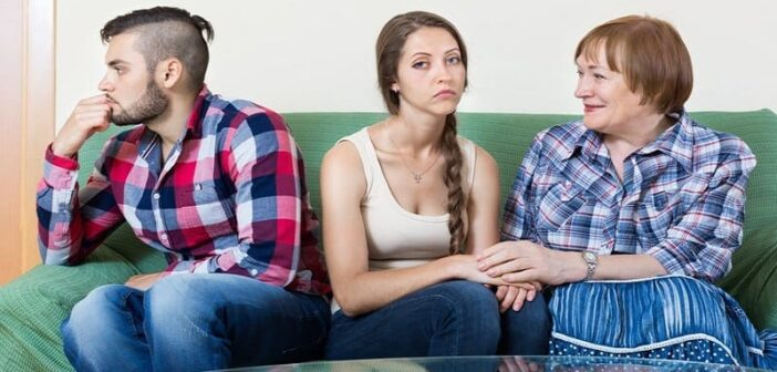 couple sitting on couch with mother-in-law