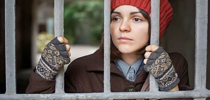 woman looking through bars - illustrating the no contact rule after a breakup with your ex
