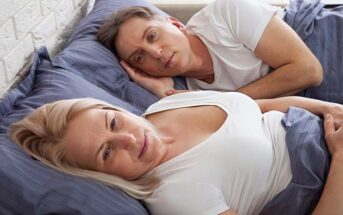 dissatisfied couple in bed who are no longer attracted to each other