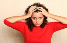 woman in red jumper with hands on head - illustrating not being a hypocrite