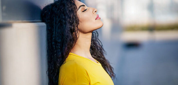 woman with her eyes closed who can't stop thinking about something
