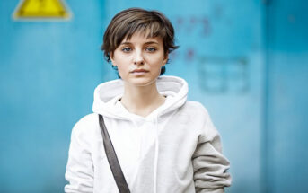 young woman in white hoodie with a fed up look on her face