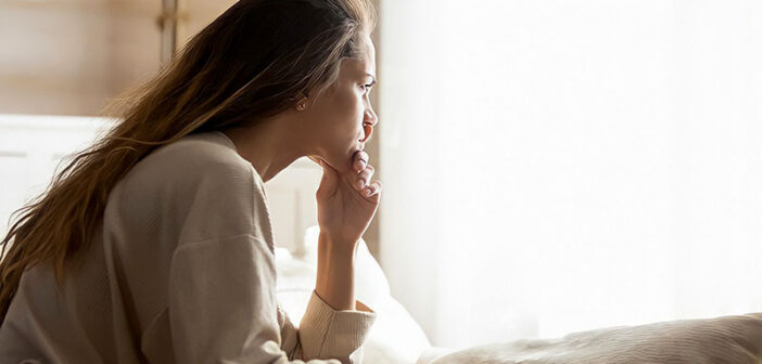 young woman looking and feeling anxious at the beginning of a new relationship