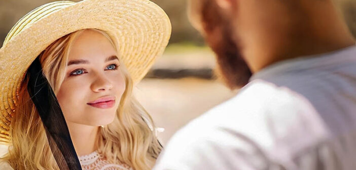 young woman looking at a man whom she is in love with