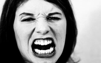 angry looking woman reacting to something stressful when she should respond instead