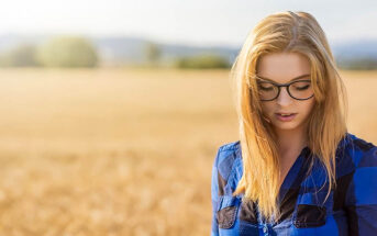 young woman looking down after failing at something
