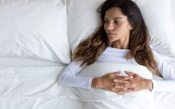 woman in bed looking at empty space next to her because she's too picky in relationships