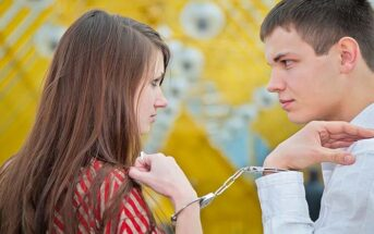 man and woman handcuffed together illustrating possessiveness in a relationship