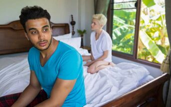 couple looking distant whilst sitting in bed illustrating not liking physical touch