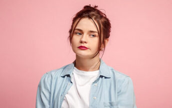 young woman looking disheartened because no one takes her seriously