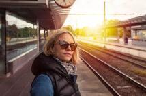 independent woman standing on train station platform