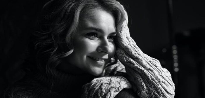 black and white photo of a smiling woman who raised her standards to improve her life