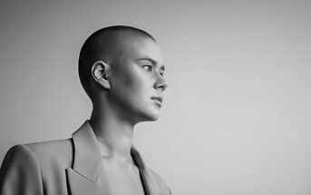 black and white photo of a bored looking bald woman - illustrating a stagnant life