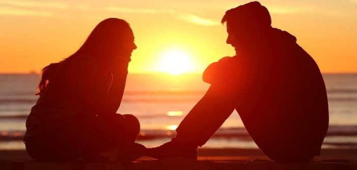 boy and girl talking with sunset in background - illustrating a guy opening up