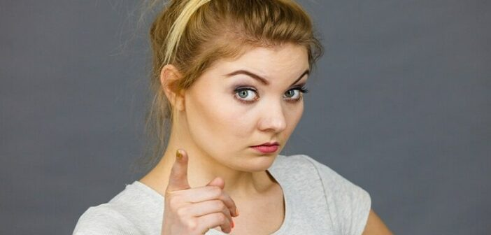 young woman pointing finger illustrating being judgmental
