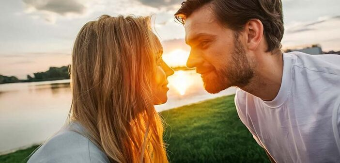 couple staring into each other's eyes at sunset - illustrating he is the one