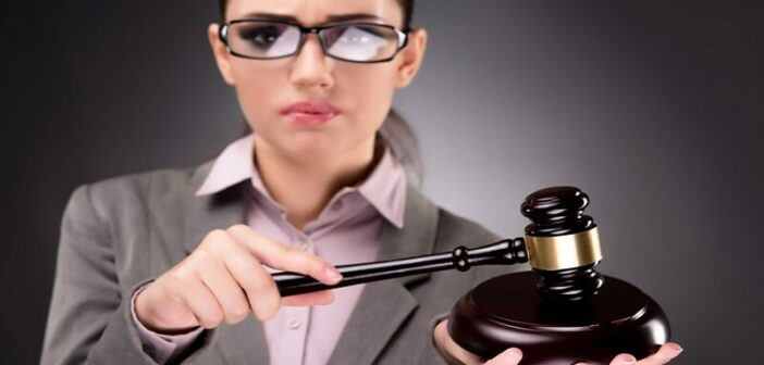 woman with gavel - illustrating judgmental people