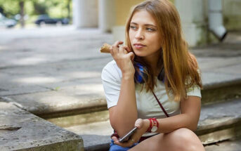bored young woman sitting on street - illustrating lost passion for something