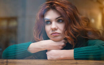young pensive woman who is obsessing over someone