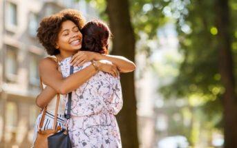 friends hugging in the street