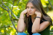 depressed looking young woman who thinks she has nothing to look forward to