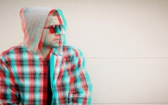 glitched photo of a man with sunglasses on - illustrating holding a grudge